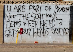 Flowers are left by a wall at the home of Robert M. Norwood, 63, who died in a clash with a passerby, police said.