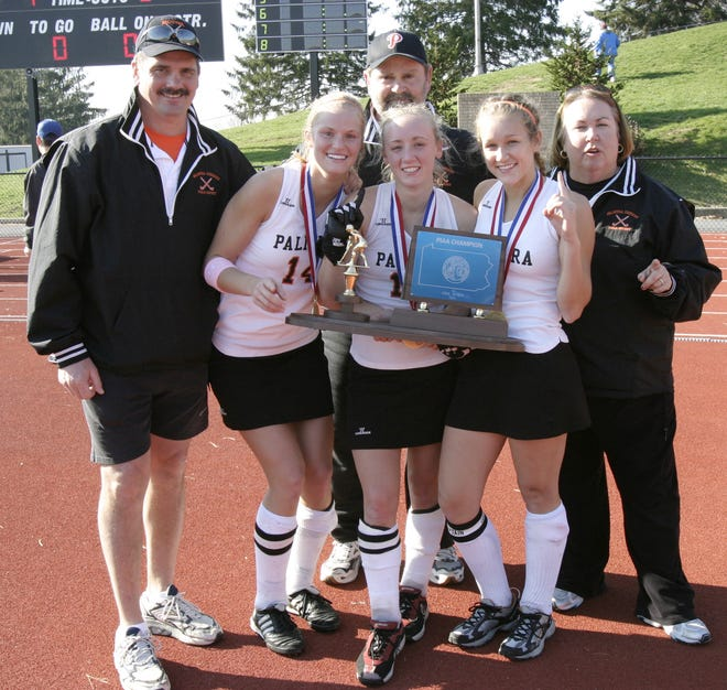 Palmyra field hockey players, from left, Amy Bonenberger, Bri Davies and Kelly Fitzpatrick pose with the 2005 2A state championship trophy with, from left, coaches Ross Fitzpatrick, Kent Harshman and Wendy Reichenbach.