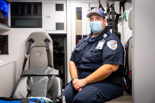 Tri-Hospital EMS paramedic Kevin Shurkey poses for a portrait Wednesday, Nov. 18, 2020, in Port Huron. Shurkey and other Tri-Hospital EMS staff members working Thanksgiving won't be able to welcome friends and families to enjoy a meal in between calls this year because of the pandemic.