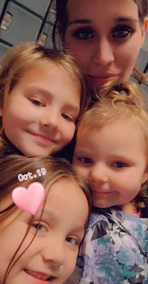 Alissa Grasak with her three daughters, Ava, Rylynn and Aubree. Grasak and her grandmother, 72-year-old Ila Grasak, died following a two-car crash in Kimball Township on Wednesday, Nov. 18, 2020.