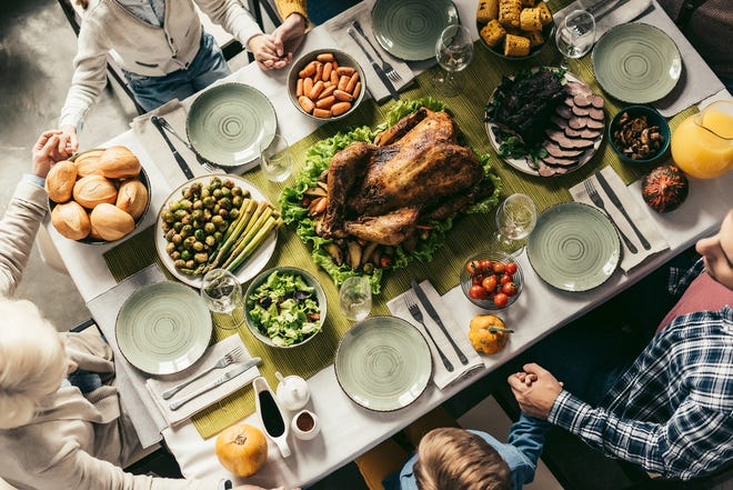 A new national survey by the Ohio State University Wexner Medical Center shows many Americans plan on attending large holiday gatherings despite spiking COVID-19 cases and hospitalizations. (Dreamstime/TNS)