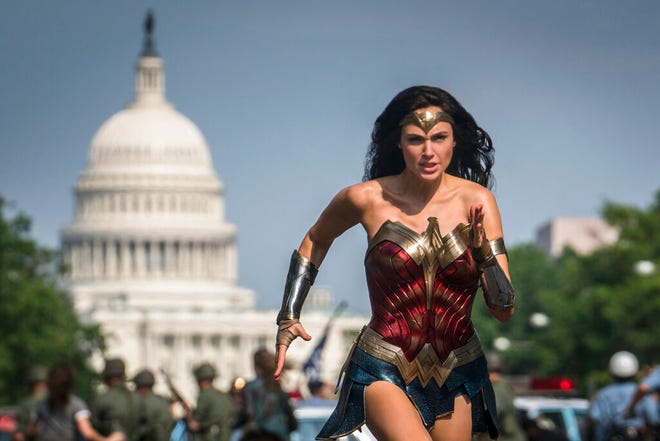 """Gal Gadot stars in """"Wonder Woman 1984."""" The film is still opening in U.S. theaters on Christmas Day, but it will also be made available to HBO Max subscribers free of charge for its first month, Warner Bros. said Wednesday."""