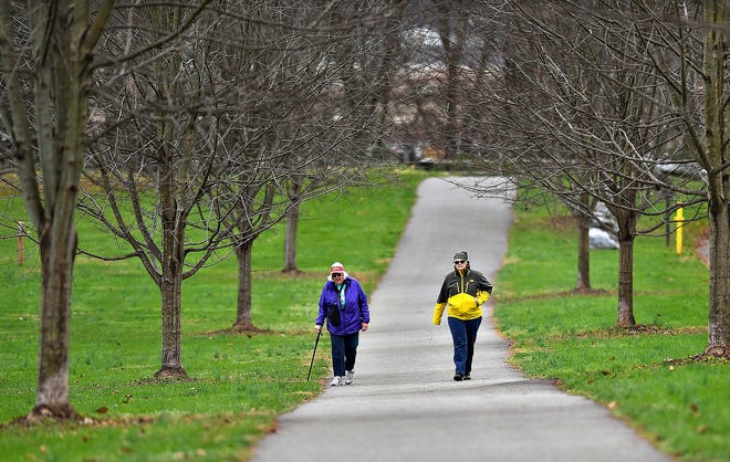 Betty Mitchell, left, and Theresa Smith, both of North Codorus Township, walk the Northern Extension of the Heritage Rail Trail head beginning at John C. Rudy County Park in East Manchester Township, Thursday, Nov. 19, 2020. The friends frequent the trails in York County weekly. Dawn J. Sagert photo