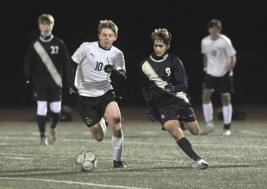 Alex Blondale (10) of Churchville-Chili and Akhil Damani of Pittsford Sutherland battle for possession during Wednesday's Class A championship.