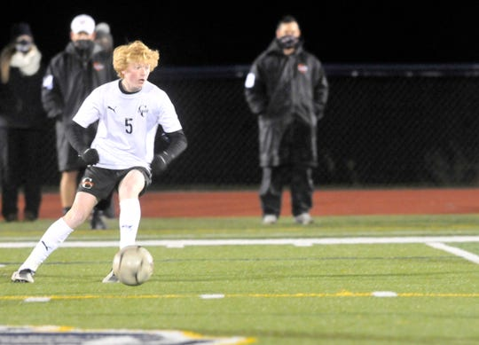 Nick Rippe of Churchville-Chili looks to move the ball upfield during Wednesday's Class A final against Pittsford Sutherland.