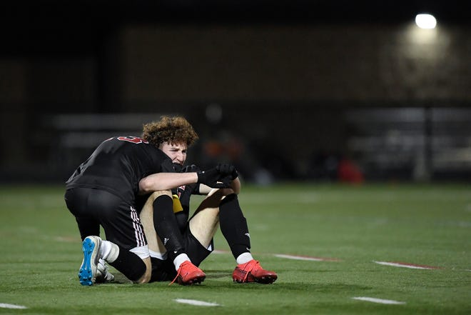 Penfield's Joe Vogt, left, hugs Shane McMillan as they celebrate their win over Fairport in the Class AA Section V Championship at Penfield High School, Wednesday, Nov. 18, 2020. No. 1 seed Penfield  won the Class AA title with a 1-0 win over No. 3 seed Fairport.