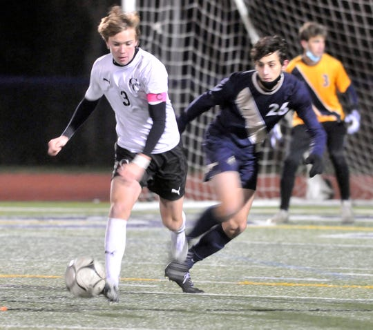 Gaven Egan (3) of Churchville-Chili keeps Ryane Petrone of Pittsford Sutherland away from the ball during Wednesday's Class A final.