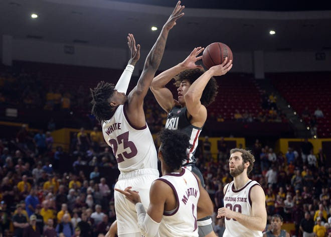 Mar 7, 2020; Tempe, Arizona, USA; Washington State Cougars forward CJ Elleby (2) shoots over Arizona State Sun Devils forward Romello White (23) during the first half at Desert Financial Arena.