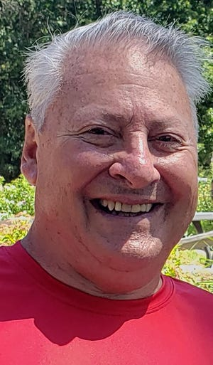 Jim Herber loved biking, volunteering and spending time with his family. He died at the age of 74 with COVID-19.