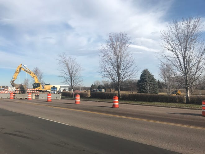 Construction crews work along South Highline Place, near where a new retail building will go, according to Sioux Falls building permits.