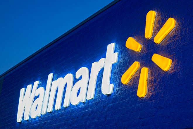 A Walmart sign is pictured.