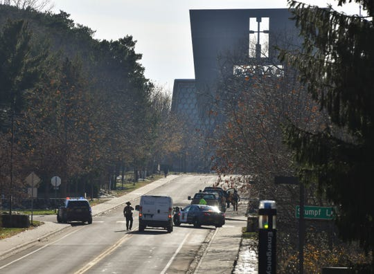 State Patrol officers stop vehicles during a campus lockdown Thursday, Nov. 19, 2020, at St. John's University.