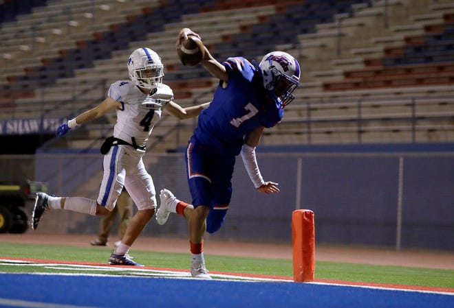 Irvin wide receiver Israel de los Santos keeps his balance and into the end zone after getting past Bowie's Jedian Sanchez. Irvin remains undefeated after their 41-7 win over Bowie High School at Irvin High School Wednesday, November, 18, 2020.