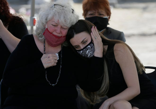 Brandy Metz, right, mourns with her grandmother Cheryl Metz, widow of El Paso historian Leon Metz, during his funeral Thursday, Nov. 19, 2020, at Concordia Cemetery in Central El Paso.