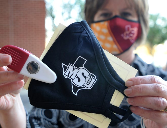 Midwestern State University, marketing director, Julie Gaynor shows one of the masks MSU donated to United Regional Hospital Thursday afternoon.