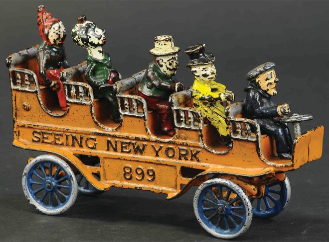 This toy tourist bus was made about 1910 by the Kenton Hardware Co. in Ohio. Not all of the passengers were part of the original toy, but suitable replacements had been found. It is a rare toy, so rare it auctioned for a little over $1,000.