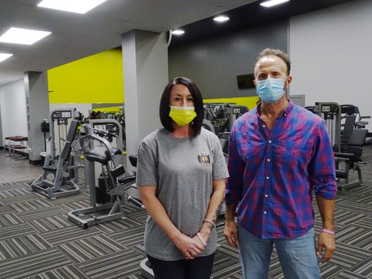 Hype Fitness manager Vicky Loterbaugh and owner David Smith spent four months prepping for the 24-hour gym's Court Drive opening. Now not facing full closure, they're still subject to a nightly curfew, which puts a dent in the round-the-clock business model.