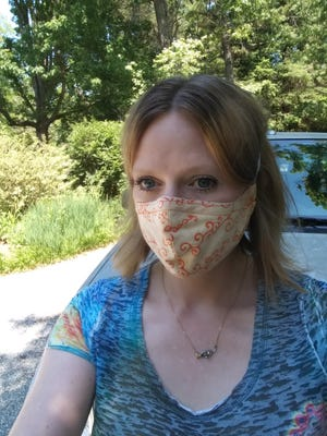 Lindsay Ann Spurgeon, 41, poses for a picture near her home in Asheville, N.C., in June of 2020. She worries about the Thanksgiving holiday because her in-person Alcoholics Anonymous meetings have been canceled due to the coronavirus pandemic.
