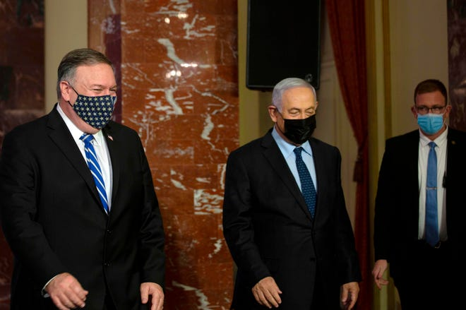 Secretary of State Mike Pompeo and Israeli Prime Minister Benjamin Netanyahu arrive to make a joint statement after meeting in Jerusalem.