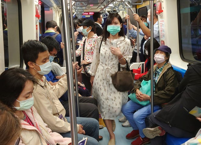 Passengers on the public metro in Taipei, Taiwan, wear face masks to help curb the spread of the coronavirus on  Nov. 16, 2020.