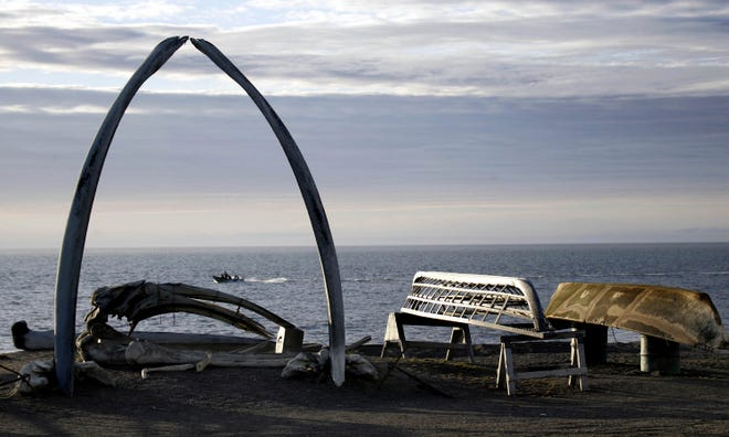 An arch made of a whale jaw sits on a beach in the  Alaskan town of Utqiaġvik in this Aug. 12, 2005, file photo. The northernmost community in the U.S. won't see the sun again until Jan. 23, 2021.