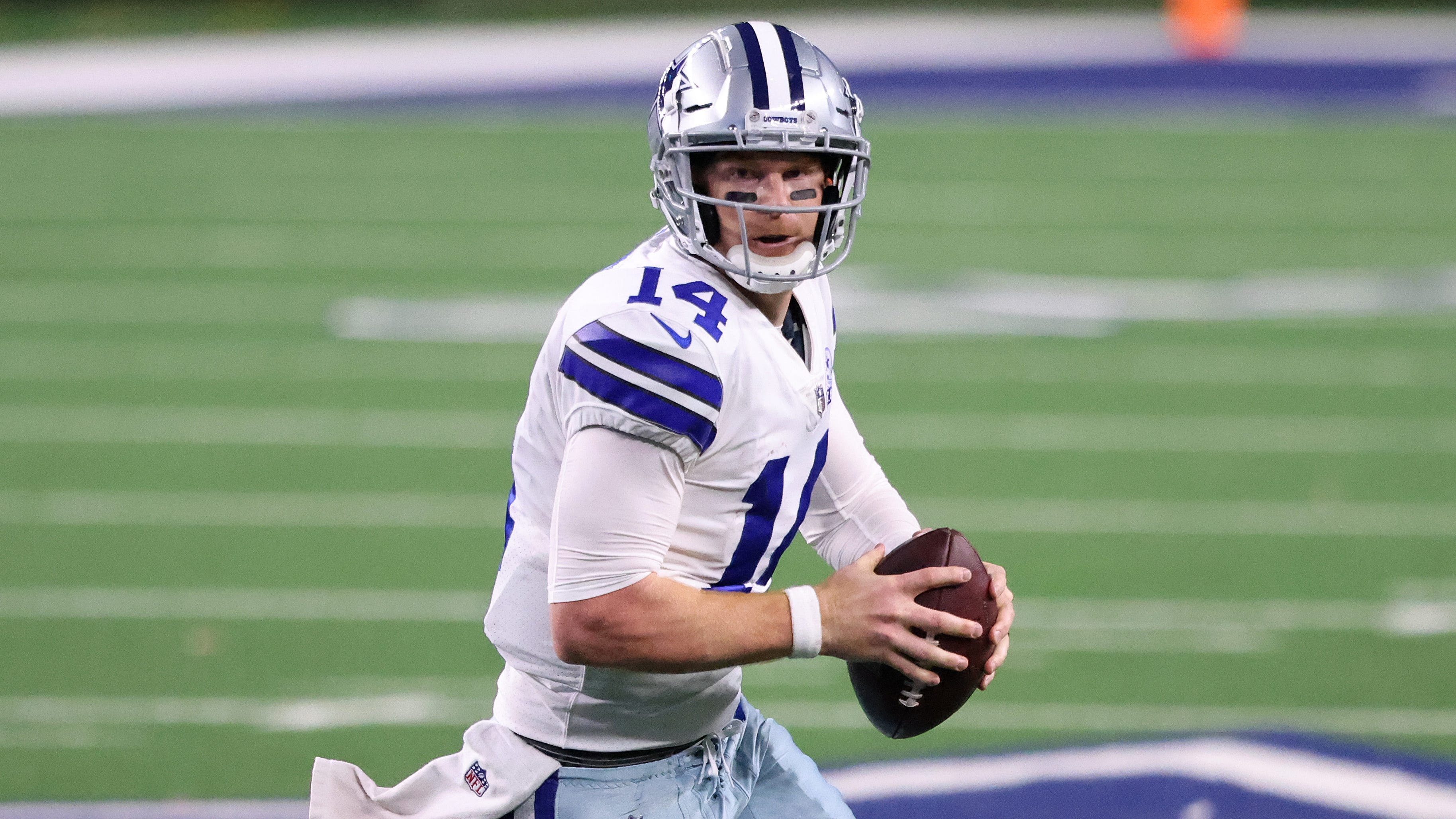 Andy Dalton #14 of the Dallas Cowboys runs against the Arizona Cardinals during the fourth quarter at AT&T Stadium on October 19, 2020, in Arlington, Texas.