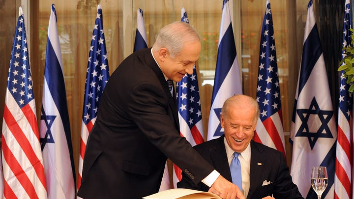 JERUSALEM, ISRAEL - MARCH 09: L - R Israeli Prime Minister Benjamin Netanyahu helps US Vice President Joe Biden as he signs the guestbook at the Prime Minister's residence on March 9, 2010 in Jerusalem, Israel. The American Vice-President is in the Middel East to meet Israeli leaders including Peres and Israeli Prime Minister Benjamin Netanyahu before travelling to Jordan on Thursday.