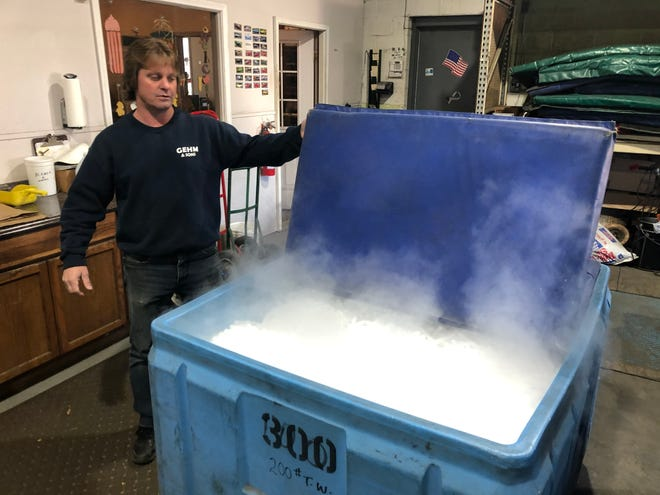 Harry Gehm, co-owner of Gehm and Sons in Akron, shows off the company's dry ice. The company has recently received about 15 calls from hospitals, retail stores and the Ohio Department of Health ready to place large orders of dry ice to safely store vaccine vials.