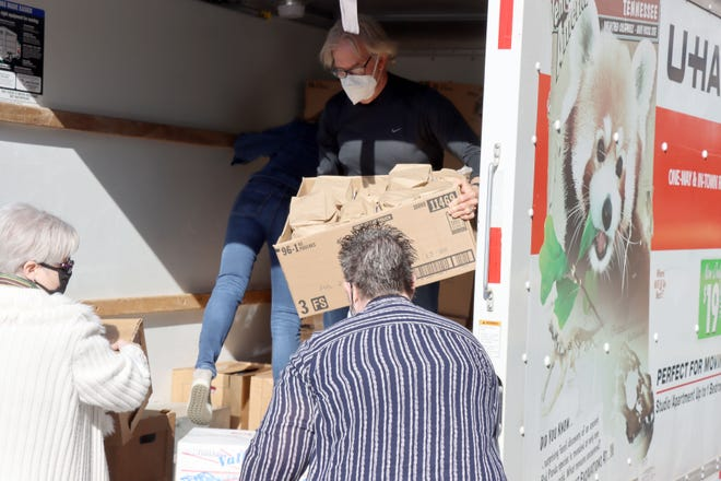 Buddy Young, one of the organizers for the project, helps unload boxes of snacks from area churches and businesses at Northwest Texas Healthcare System Friday morning to show support for the nurses and staff for the work they do. [Neil Starkey / For the Amarillo Globe-News]