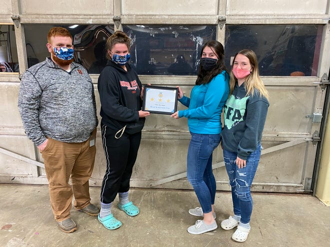 Buckeye FFA Adviser Geoffery Norris and Chapter President Cora Gunkleman present Black River FFA President Cassidy Mrakuzic and Vice President Katlyn Kubitz with the National Chapter 3-Star Recognition Award.