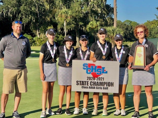 The May River High School golf team celebrates its undefeated championship season Oct. 27 on Hilton Head Island.  Left to right: Athletic director Brett Macy, Hailey Aipperspach, Robbin Zetrouer, Kylie Bowes, Hannah Harris, Sydney Bowes and coach Kelly Minasi.