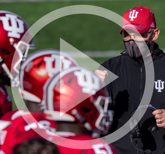 In this Saturday, Nov. 7, 2020, file photo, Indiana head coach Tom Allen looks towards his players on the sideline during a break in the second half of an NCAA college football game against Michigan in Bloomington, Ind.