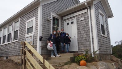 The one-room schoolhouse on Cuttyhunk, which closed last year after its lone student graduated, has reopened to accommodate four students whose families, typically seasonal residents, have decided to stay on the island full time during the pandemic. From left are Lola Gahan, Lucy Lombard, Hannah Frothingham and Colby Frothingham,