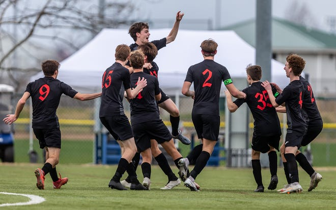Southern Boone's Mason Ahern, arm raised, is mobbed after scoring the winning goal during a 1-0 victory over Whitfield in the Class 1 championship soccer match Friday in Springfield.