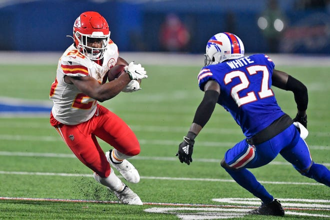 Kansas City Chiefs running back Clyde Edwards-Helaire (25) runs the ball as Buffalo Bills cornerback Tre'Davious White (27) defends during a game Oct. 19 in Orchard Park, N.Y.