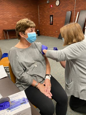 Patricia Iams, 73, of Upper Arlington was the first person to participate in a COVID-19 vaccine trial at the Ohio State University Wexner Medical Center. Ohio State is seeking 500 volunteers to participate in the trial for a vaccine being developed by AstraZeneca.