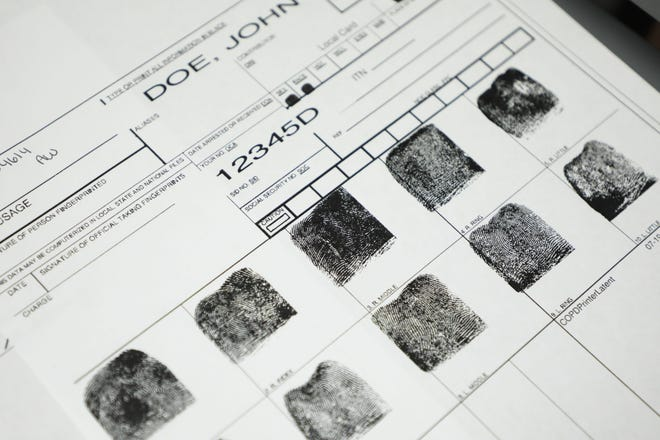 Fingerprints for a John Doe on Sept. 17, 2019, at the Columbus Division of Police Forensic Services Center in Columbus, Ohio. In letter, dated Wednesday, to law enforcement and courts, Attorney General Dave Yost's office reinforced their legal obligation to provide fingerprints and arrest records to keep updated state records used to run background checks for those purchasing guns or obtaining a concealed carry permit.