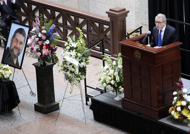 Gov. Mike DeWine spoke during a memorial for Dispatch reporter Jim Siegel in the Statehouse atrium on June 17, 2019. Siegel, 46, died six days earlier.