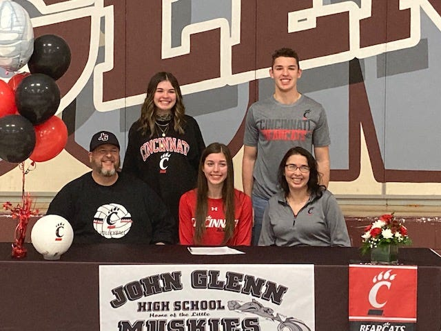 John Glenn senior Abigail Walker (seated, center) signed her letter of intent to play volleyball for the University of Cincinnati on Friday. Also pictured are her parents: father Jason Walker (seated, left) and mother Sandi Walker (seated, right), while her siblings, sister Madison and brother Tyler Walker, are standing.