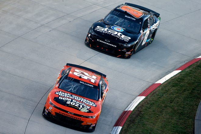 Josh Williams, driver of the No. 92 Sleep Well/Alloy Chevrolet, and Jeb Burton, driver of the No. 8 State Water Heaters Chevrolet, race during the NASCAR Xfinity Series Draft Top 250 at Martinsville Speedway on Oct. 31, 2020 in Martinsville, Virginia.