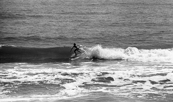 Flagler County surfer Frieda Zamba takes to the waves off Flagler Beach in May 1981.