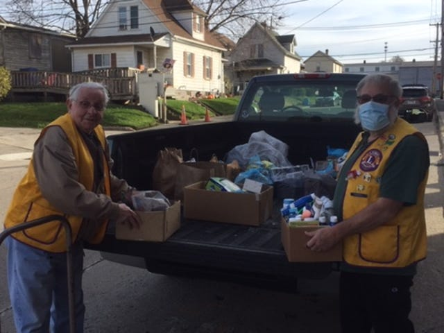 The Riverside Lions conducted an overnight food drive last week to support the Holy Redeemer Food Bank.Unloading the truck is Lion Jim Westlund, left, and DG Chip Campbell.
