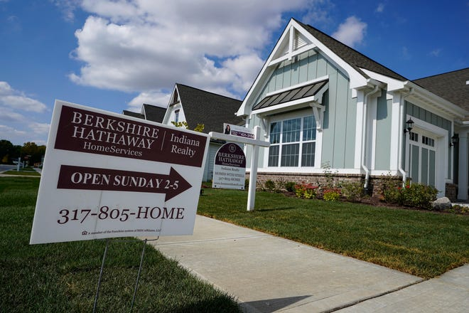 An open house is posted in front of a home for sale in Westfield, Ind., in September. Sales of existing homes rose for a fifth straight month in October, the National Association of Realtors said Nov. 19. Existing homes sales rose 4.3% to a seasonally-adjusted rate of 6.85 million annualized units.
