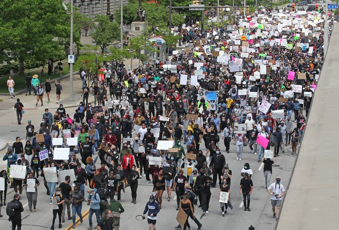 Thousands of protesters walk down Lakeside Avenue in Cleveland toward the Justice Center during a rally May 30 honoring George Floyd, who died in the hands of Minneapolis police on May 25. Later that day, the rally turned into a riot. Days later, the FBI charged Brandon Michael Althof-Long and Devon Bryce Poland, both of Erie, with the offenses of use of fire to commit a felony and rioting.