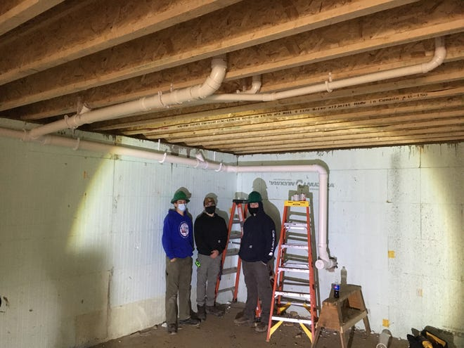 Alfred State HVAC students recently helped the Allegany County Land Bank Corporation with installing a plumbing system in a new house in Wellsville. Pictured, from left to right, are Tom Dycha, Jesse Kabat, and Noah Scott.