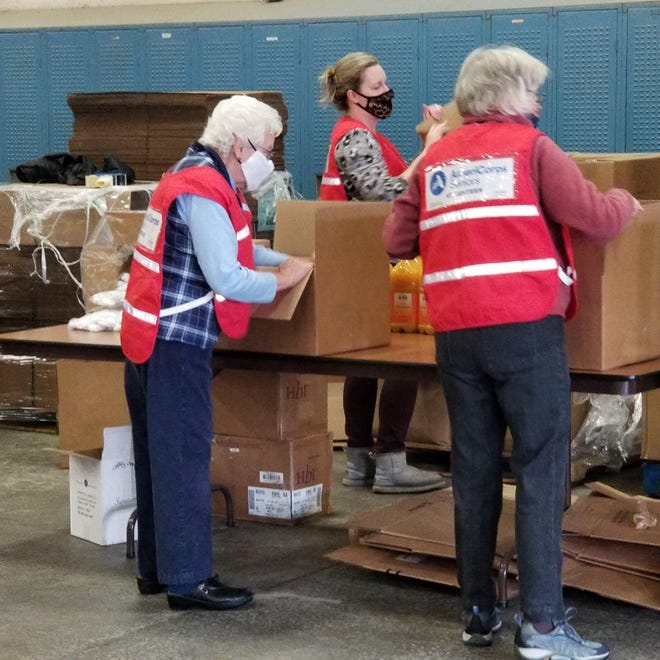 Steuben volunteers pack boxes for seniors.