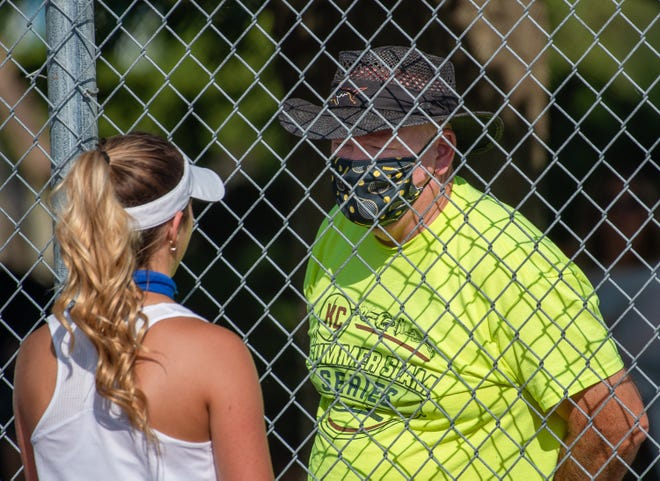 Grain Valley tennis coach Randy Draper talks with senior Chelsea Gorden during a match this season. Draper was named the NFHS/MSHSAA Boys Tennis Coach of the Year for 2019-20. There was no boys season this spring but Draper was honored for his overall work.