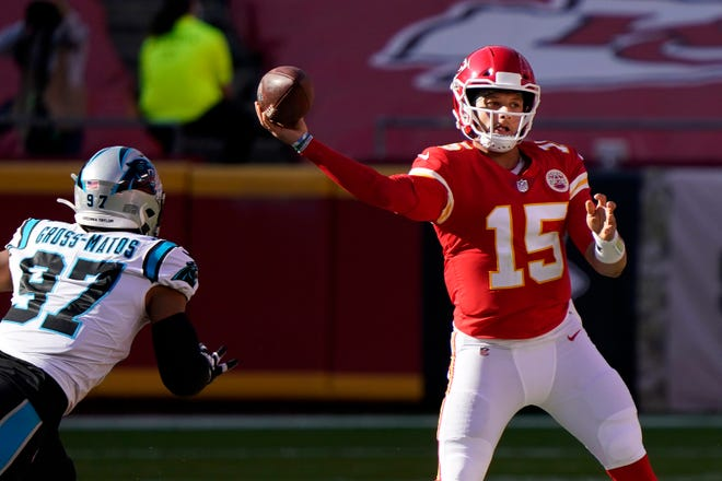 Kansas City Chiefs quarterback Patrick Mahomes (15) passes as Carolina Panthers defensive end Yetur Gross-Matos (97) applies pressure in a Nov. 8 game. The Raiders; the Chiefs' opponent this week, handed the Chiefs their only loss this season by getting pressure on Mahomes.