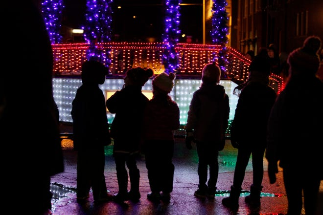 Silhouetted children watch as lighted floats pass by during the 25th annual Parade of Lights Nov. 27, 2015, in Fort Madison. Fort Madison Lighted Parade is 6:30 p.m. Friday along Avenue G. The Enchanted Forest at 927 Avenue G, behind Aldi, will open after the parade, and be open from 10 a.m. to 2 p.m. Nov. 28, 5 to 7 p.m. Dec. 1, 8 and 15, and 2 to 4 p.m. Dec. 5, 12 and 19.
