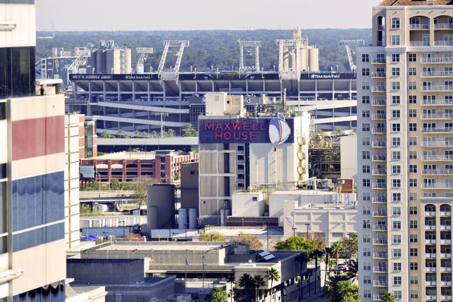 Maxwell House plant in downtown Jacksonville with TIAA Bank Field in the background Thursday, December 5, 2019. [Bob Self/Florida Times-Union]